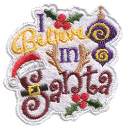 This white felt patch has the text 'I Believe In Santa'. At the top the 'I' sits next to three holly berries and leaves. To the right of the 'Believe' and 'In' hangs a two tiered purple lantern. The word 'Santa' has the 'S' wearing a Santa had and belt and the 'n' has reindeer antlers. Underneath the word 'Santa', in the mirror image of the top, is another clump of holly berries and leaves.