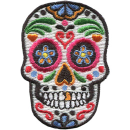 This skull is decorated in a variety of designs and colours, turning it into a sugar skull.