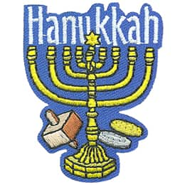 A Hanukkah menorah stands in the center of this crest. To the left is a dreidel and to the right are two sufganiyots.