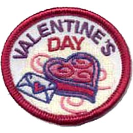 This round, red merrow bordered crest displays an image of a heart shaped box of chocolates with a heart sealed envelope beside it. At the top are the words ''Valentine's Day.''