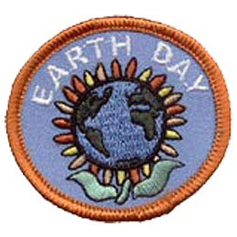 This round patch displays a sunflower where the head is Earth itself. The words Earth Day arch over the flower.