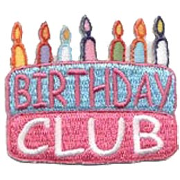 A two layered birthday cake is decorated with seven different coloured birthday candles. The word \'\'Birthday\'\' is written in pink on the top blue layer and \'\'Club\'\' is written in white on the bottom pink layer.