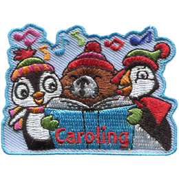 From left to right: A penguin, beaver, and puffin sing carols out of a songbook. The beaver is holding the book. Music notes dance above these adorable creatures.