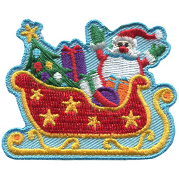 Santa stands behind his large red sleigh packed full of presents and a Christmas tree. The back of the sleigh is on the left and holds the Christmas tree. The center and front of the sleigh hold three wrapped presents and a toy ball. Santa stands on the left, behind the sleigh, with his hands up in the air.