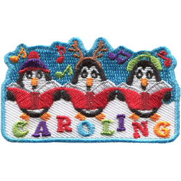 Three penguins sing carols out of red song books. From left to right the penguins wear: a toque, reindeer antlers, and earmuffs. Music notes dance around these adorable creatures and the word 'Caroling' sits underneath them.