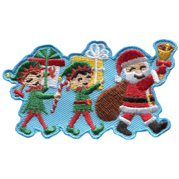 Santa leads two of his elven helpers in a parade. Each of the elves is packing a present and Santa holds a bell and his present sack.