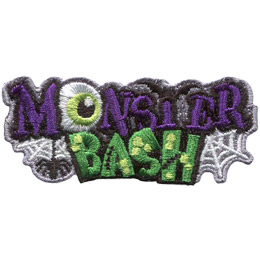 This crest is comprised of the word 'Monster' stacked on top of 'Bash'. A spider dangles from the letter 'M', the 'O' has been replaced by an eyeball, and the 'T' is a bat with its wings outspread. 'Bash' is covered in yellow warts and has stitches in the 'A' and 'H'.