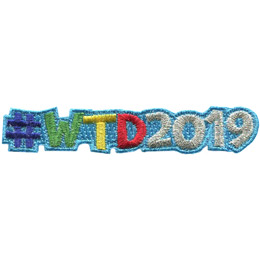 This patch contains the hashtag symbol followed by the letters 'WTD' and then the numbers '2019' to represent hashtag world thinking day 2019. The numbers are embroidered with a silver metallic thread.