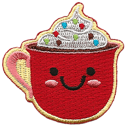 A red mug of cocoa is topped with whipped cream and sprinkles. The mug has dots for eyes and a big U shaped smile.