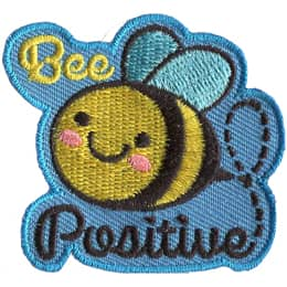 A cute bee has dots for eyes and a big U shaped smile. The word \'Bee\' is embroidered above the creature and \'Positive\' below.