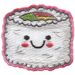 A piece of rice coated sushi has a center of green, pink, and yellow. The sushi has a kawaii face consisting of two black dots for its eyes, a big U forms a smile, and pink blush colours the sushi\'s cheeks.