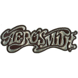 The band name \'Aerosmith\' is written in wispy, smokey letters. The background is solid black.