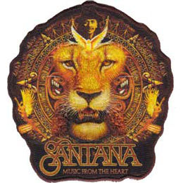 This crest shows the Santana lion (the face of a lion with his mane appearing like an Aztec calendar) with the Santana logo and \'Music From The Heart\' written underneath.