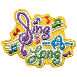 The text \'Sing A Long\' forms the bulk of this crest with music bars and notes in the background. The \'S\' in \'Sing\' is a backwards treble-clef.