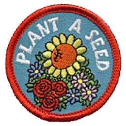 A red merrow border surrounds this circular patch. In the center lies a bunch of flowers consisting of daisies, roses, and a sunflower. The words 'Plant A Seed' arch over top of the flowers.