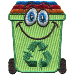 A cute green recycle bin with kooky eyes.