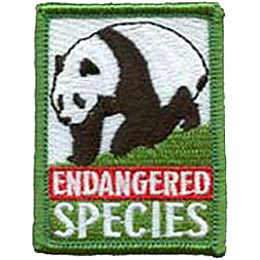 A beautiful panda walks down a green hill. The words ''Endangered Species'' are embroidered underneath the panda.