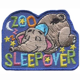 An elephant in his little night cap sleeps soundly under the stars and the moon. The words \'Zoo Sleepover\' are embroidered in a variety of pastel colours.