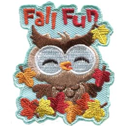 A little owl frolics in the orange, yellow, and red leaves of autumn. The words \'Fall Fun\' are above the owl\'s head.