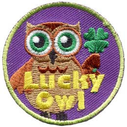 A brown owl with big green eyes holds a four leaf clover in his wing. The words, ''Lucky Owl'' is written in yellow near the bottom of the patch.