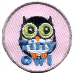 A small black owl with a white belly stares off into the distance. The words ''Tiny Owl'' are written in blue text near the bottom of the patch.