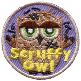 A untidy owl stands in defiance of his shabby appearance as flies buzz around him. The words 'Scruffy Owl' are embroidered in yellow at the bottom of this round patch.
