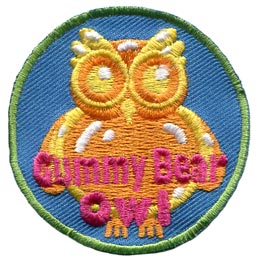 This orange gummy owl is a stitched representation of the tasty gummy bear treat. The words 'Gummy Bear Owl' are embroidered near the bottom of the emblem.