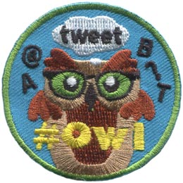 This brown owl is surrounded by social media speak and symbols. \'A, @, tweet, B, ?,\' and \'T\' float around the owl and the embroidered text \'# Owl\' is situated at the bottom of the patch.