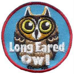 This yellow-faced, brown and tawny owl has big, long ears that stand like two horns on top of its head. The words 'Long Eared Owl' sit at the bottom of this round patch.