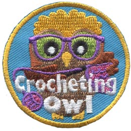 An elderly owl with glasses crochets with her yarn and needle. The words 'Crocheting Owl' are embroidered on the patch.