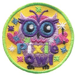 This purple and pink owl has antenna like a pixie. She holds a magic wand as sparkles rain down on her. Pink, white, yellow, green, and purple threads make up the word 'Pixie' and 'Owl' is written in purple.