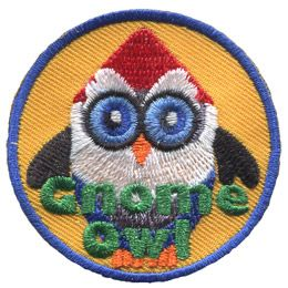 This owl stands as still as a statue. This red pointed hat, white beard, black gloves, and blue overalls make him look just like a garden gnome. The words 'Gnome Owl' are embroidered in green thread.