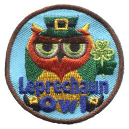 This owl is dressed up like a leprechaun, complete with hat, beard, coat, and three-leaf clover. The words 'Leprechaun Owl' are embroidered in blue threads at the bottom.