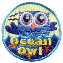 A blue owl is swimming in the ocean. The words 'Ocean Owl' are embroidered at the bottom of this round patch.