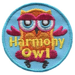 An owl sits with his legs crossed and his wings spread out, looking as if he is meditating or preforming a yoga pose. The words 'Harmony Owl' is embroidered in yellow thread.