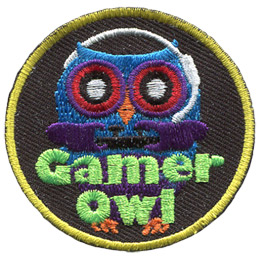 A blue owl sits in the dark, his purple wings grasping a gaming controller as he listens and speaks to his headset. The word 'Gamer Owl' is embroidered in lime green at the bottom.
