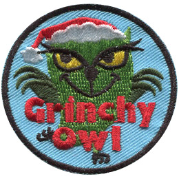 This round badge displays a green owl with a grinchy face wearing a Santa hat.The words, 'Grinchy Owl' are embroidered at the bottom.