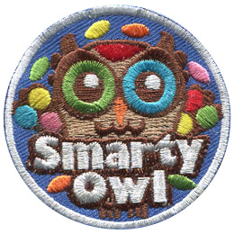 This brown owl has one green eye and one blue eye. The owl is surrounded by colourful little candies. Near the bottom of this circular crest is the text 'Smarty Owl'.