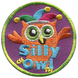 This orange owl wears a jester's hat as it fools around. Near the bottom of this circular patch is the text 'Silly Owl'.