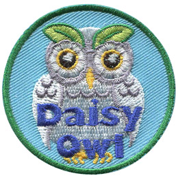 This owl has white feathers and round eyes that look like daisy petals. Two leaves arch up over the eyes as eyebrows. The text 'Daisy Owl' is embroidered near the bottom of this circular patch.