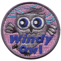 This grey owl dances in the wind. Whispy blue lines in the background indicate a breeze is blowing. The text 'Windy Owl' is embroidered near the bottom of this circular patch.