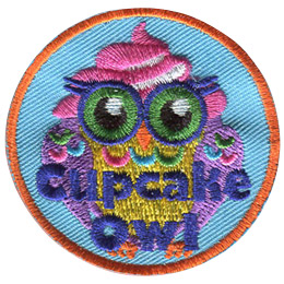 This circular patch displays a cupcake owl. This colourful owl has purple wings, a yellow body, a pink icing swirl on its head and blue, green, and pink feather decorations. Embroidered at the bottom of the crest are the words 'Cupcake Owl.'