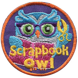 This circular patch shows a bespectacled owl holding scissors in one wing and a scrapbook in the other. The text at the bottom of the crest reads, 'Scrapbook Owl.'