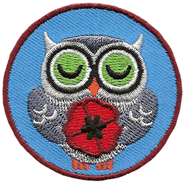 This circular patch displays a grey owl with his eyes closed and his wings holding a poppy.