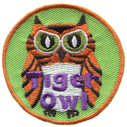 This fierce looking owl is orange and black stripped, like a tiger. The words \'Tiger Owl\' are embroidered near the bottom of this round crest.