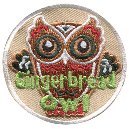 This owl is made of gingerbread. The image is of an owl cookie shape with the eyes, feathers, and outline of an owl decorated with icing. The text 'Gingerbread Owl' sits near the bottom of this round patch.