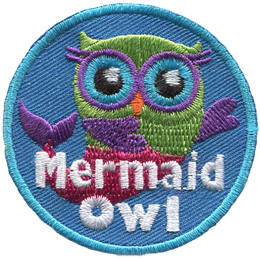 A green owl with a pink and purple mermaid tail swims gracefully through an ocean blue background.