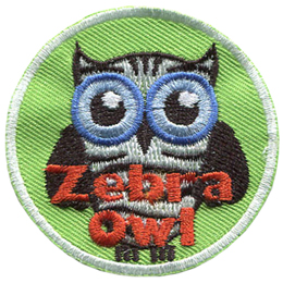 This round badge displays an owl with big blue eyes and a body striped black and white like a zebra. The text at the bottom of the crest reads Zebra Owl.