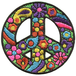 This peace sign in decorated with a paisley pattern complete with flowers and wild colors.