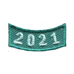This 1.0 inch wide by 0.5 inch high green rocker curves upwards like a smile. The year 2021 is embroidered in a bold font.